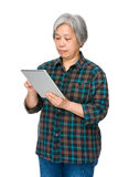 Old woman learn to use tablet Stock Photography