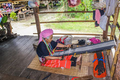 Karen long neck old woman at loom Royalty Free Stock Photos