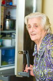 Old woman looking for food Stock Photos