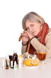 Old woman looking at pills Royalty Free Stock Images