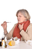 An old woman looking at a thermometer Stock Photos
