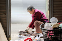 Old woman and Make recycling Royalty Free Stock Images