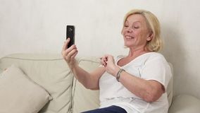 Old woman making a selfie