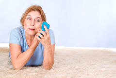 Old woman making up Stock Photography