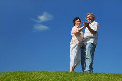 Old woman and man dancing on lawn Stock Image
