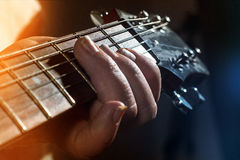 Old, woman, man  playing electric, acoustic guitar, black backgr Royalty Free Stock Image
