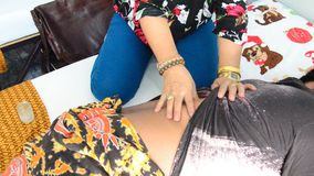 Old woman massaging thai style for thai man stock video footage