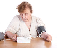 The old woman measures arterial pressure upon Royalty Free Stock Photos