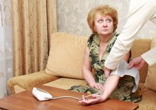 Old woman measures arterial pressure. Stock Photography