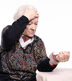 The old woman measures arterial pressure. On a white background stock photos