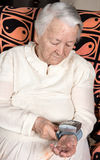 Old woman measures arterial pressure Royalty Free Stock Photography