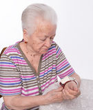 Old woman measures arterial pressure Royalty Free Stock Images