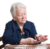 Old woman measures arterial pressure Royalty Free Stock Image