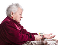 Old woman measures arterial pressure Stock Photo