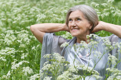 Old woman in the middle Stock Images