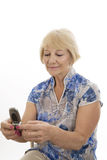 Old woman with mobile phone Stock Photo