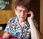 Old woman with mobile phone Royalty Free Stock Photo