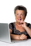 Old woman with modern laptop Royalty Free Stock Photo