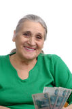 Old woman with money Royalty Free Stock Images