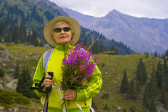 Old woman in mountain Stock Photo