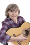 Old woman musician posing with her guitar. Retired woman musician posing with her guitar on white background Stock Image