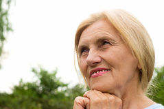 Old woman at nature Royalty Free Stock Image