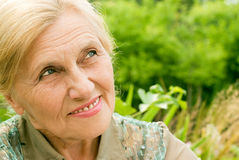 Old woman at nature Stock Images