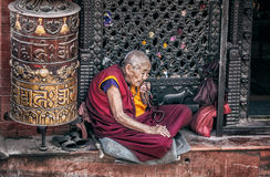 Old woman near Bodnath stupa Royalty Free Stock Photo