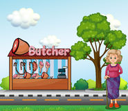 An old woman near the butcher house Royalty Free Stock Image
