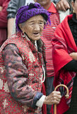 Old woman in Northern Yunnan Province. An old woman walks through the crowded streets of Zhongdian during a festival in northern Yunnan province in China Royalty Free Stock Image