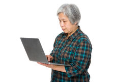 Old woman with a notebook Stock Image
