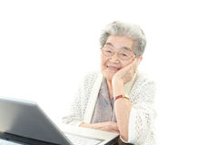 Old woman with a notebook Stock Photography