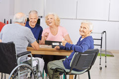 Old woman in nursing home playing Stock Photo