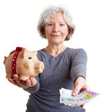 Old woman offering banknotes Royalty Free Stock Photography