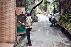 CANTON, CHINA – CIRCA FEBRUARY 2018: An old woman offers a sacrifice to the Heavenly official. An old woman offers a sacrifice to the Heavenly official Royalty Free Stock Images