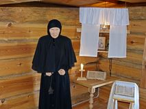 Old woman old believer in the prayer room. At the inn. The on 1st floor. Museum-reserve of wooden architecture and folk art Nizhnyaya Sinyachikha, Sverdlovsk royalty free stock image