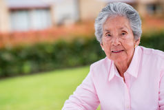 Old woman outdoors Stock Photo