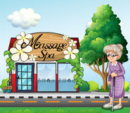 An old woman outside the massage spa parlor Royalty Free Stock Photo