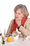 Old woman with pain in the throat. Portrait of an old woman with pain in the throat over a white background stock photo