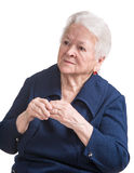 Old woman with painful fingers. On a white background Stock Photos