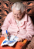 Old woman painting for fun Royalty Free Stock Photos
