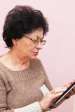Old Woman and PC Tablet Royalty Free Stock Photos
