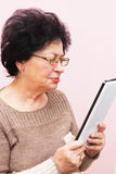 Old Woman and PC Tablet Stock Photo