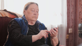 Old Woman pensioner speaks on cell phone, telephoto royalty free stock photos