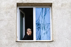 Old woman pensioner window copy space Stock Images