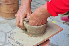 An old woman is performing the ceramic molding techniques at the Po Nagar temple in Nha Trang. Nha Trang, Vietnam - July 11, 2015: An old woman is performing the Royalty Free Stock Photography