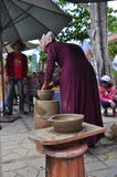 An old woman is performing the ceramic molding techniques at the Po Nagar temple in Nha Trang Stock Image