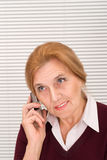 Old woman with phone Royalty Free Stock Photography