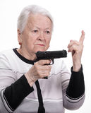 Old woman with pistol Stock Photo