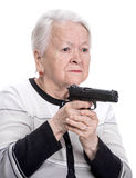 Old woman with pistol. On a white background Royalty Free Stock Photos